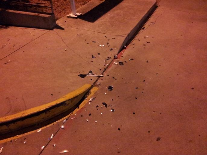 car debris at the curb